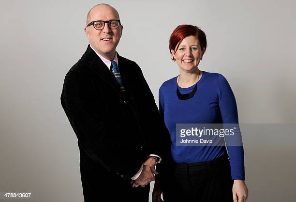 A smart mature couple on white background