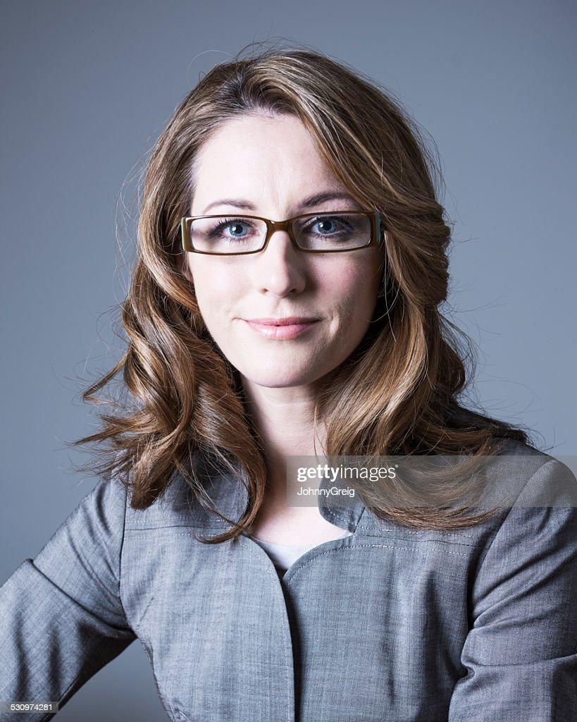 Smart mid adult Caucasian business woman