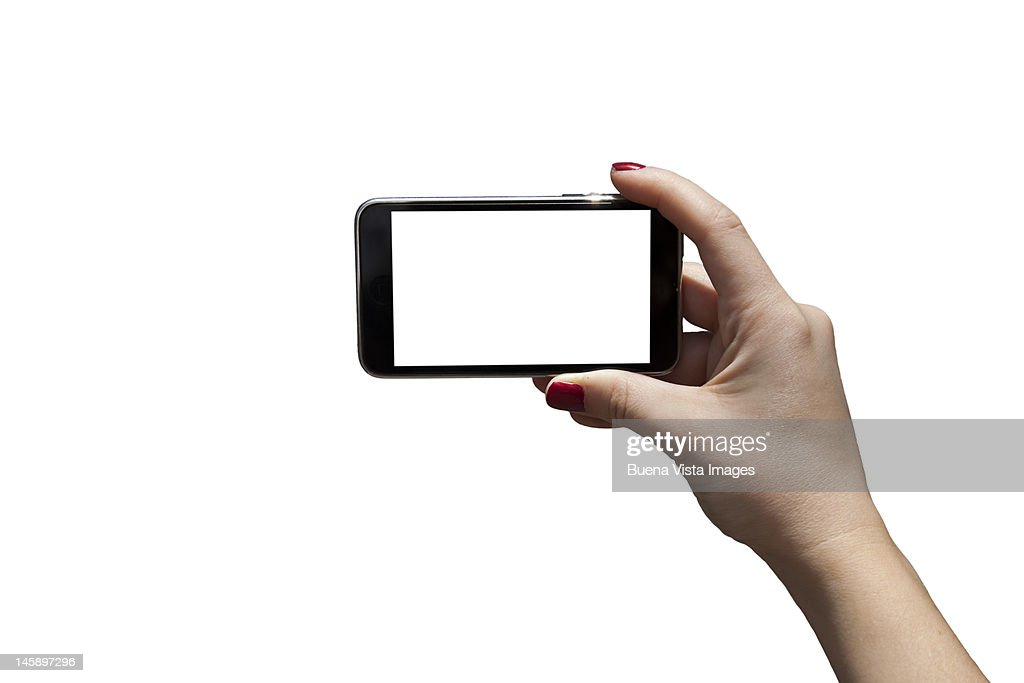 Smart phone in woman's hand used as a camera in a