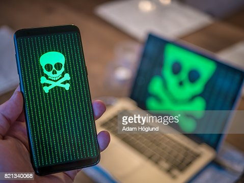 Smart phone is hacked with virus. Computer in background. : Stock Photo