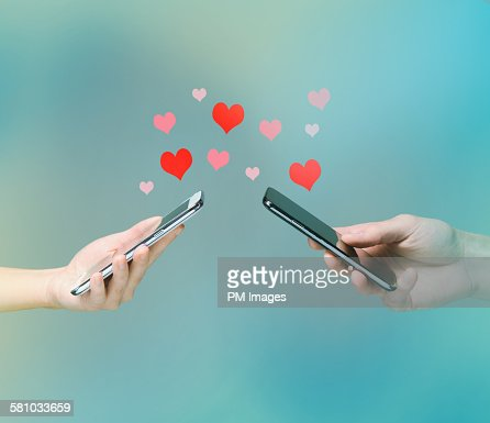 Smart phone love connection : Stock Photo