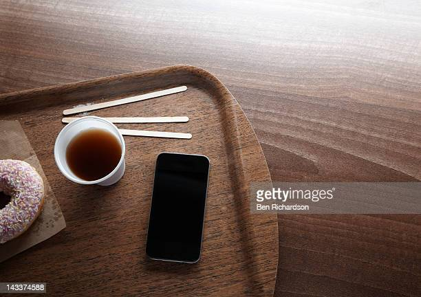 Smart phone on coffee tray