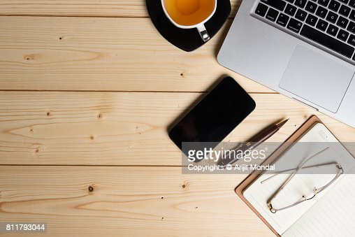 Wooden Office Table Top View With Copy Space Green Tea Laptop