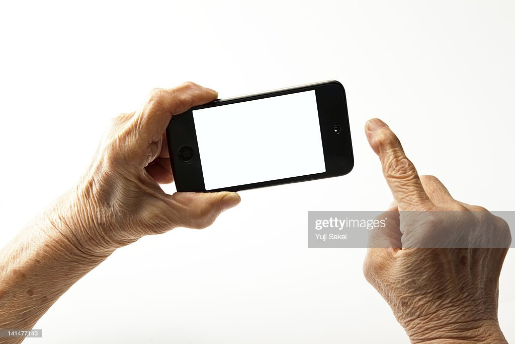 smart phone with  a hand of senior woman : Stock Photo