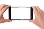 human hands taking photo with a mobile phone isolated over a white background