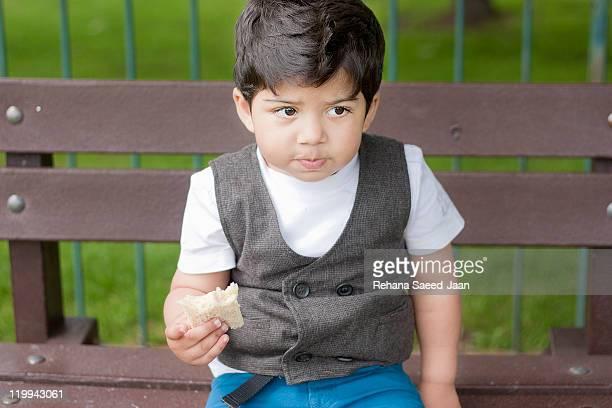 Smart toddler boy having lunch