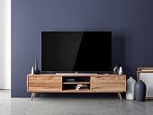 Smart Tv mockup standing on the wooden console in modern interior with home decor, 3d rendering