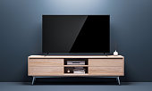 Smart Tv Mockup with black glossy screen on console in living room. 3d rendering