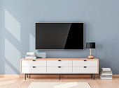 Smart Tv Mockup with blank screen hanging on the wall in modern living room. 3d rendering