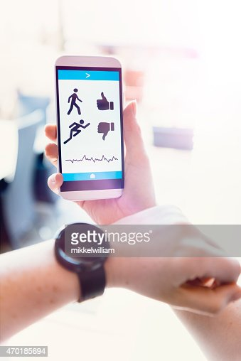 Smart watch and mobile phone with app tracks activity