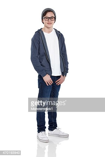 Smart young boy wearing glasses and cap posing on white : Stock Photo