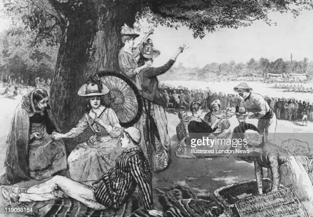 A smartllydressed spectator has her palm read by a fortune teller during Henley Royal Regatta HenleyonThames Oxfordshire July 1888 Original...