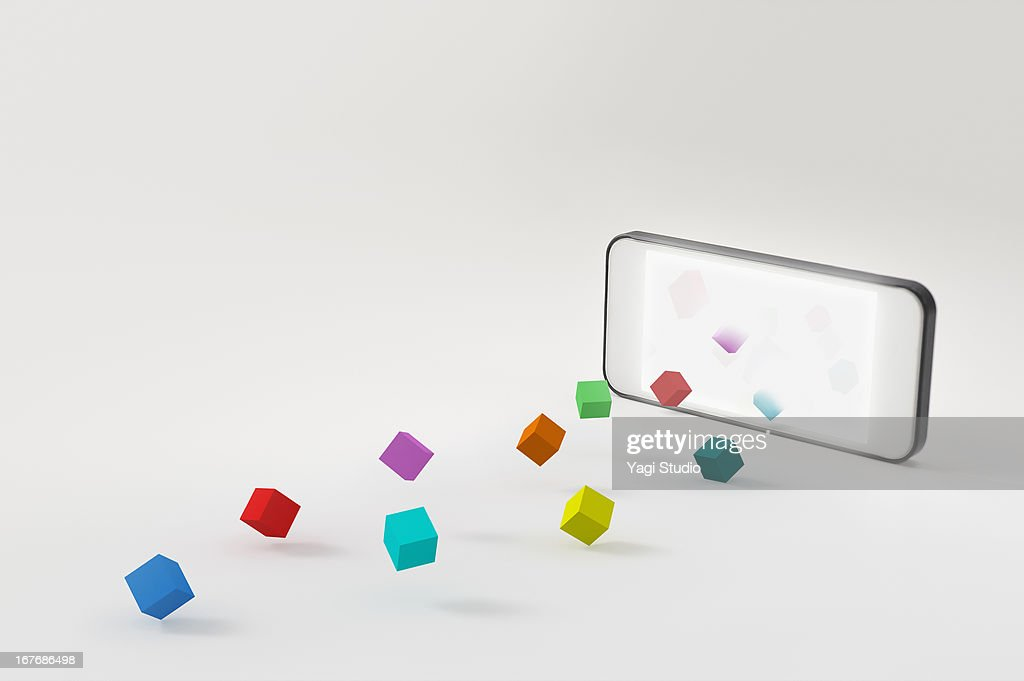 A smartphone and a block : Stock Photo