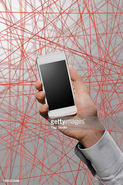 smartphone and a red thread
