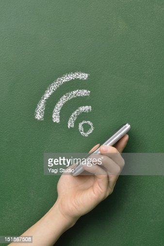 A smartphone and a wireless network : Stock Photo