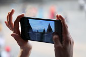 Taking photo using smart phone, cell, phone,cellphone with camera or phablet. Human hands holding electronic device.