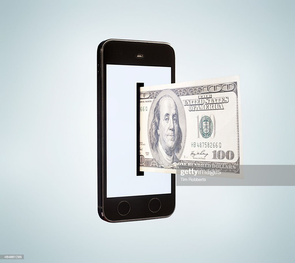 Smartphone dispensing 100 dollar bill. : Stock Photo