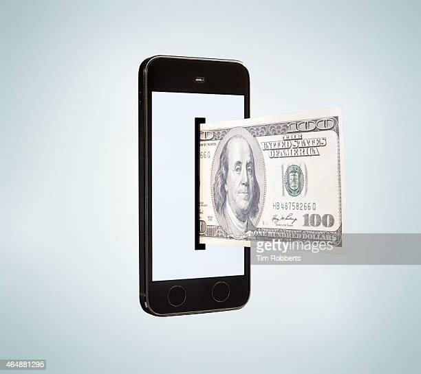 Smartphone dispensing 100 dollar bill.
