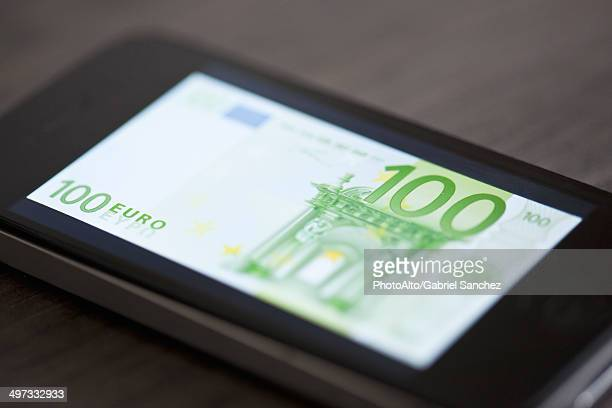 Smartphone displaying image of one-hundred euro banknote