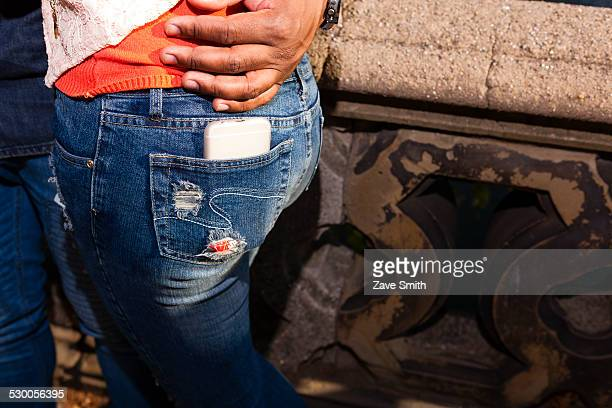 Smartphone in back pocket of jeans