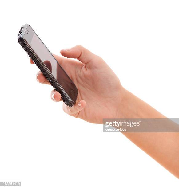 Smartphone in woman hand on white