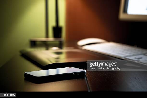 smartphone on black desktop