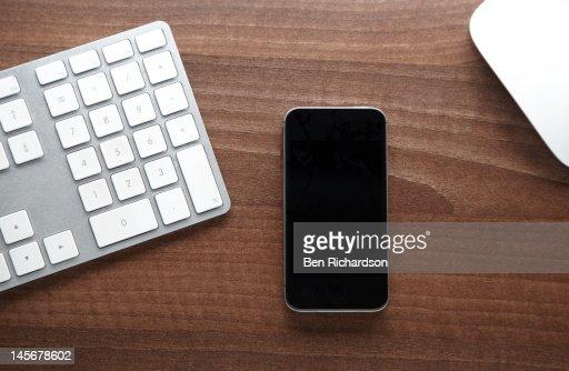 Smartphone on desk : Stock Photo