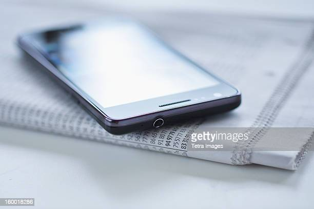 Smartphone on newspaper