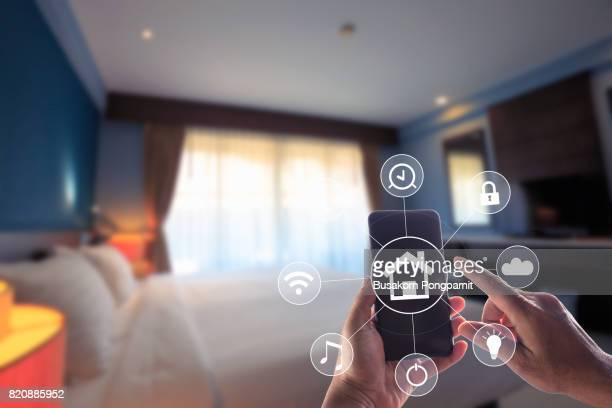 Smartphone remote home control system app. Bed Room interior in background.
