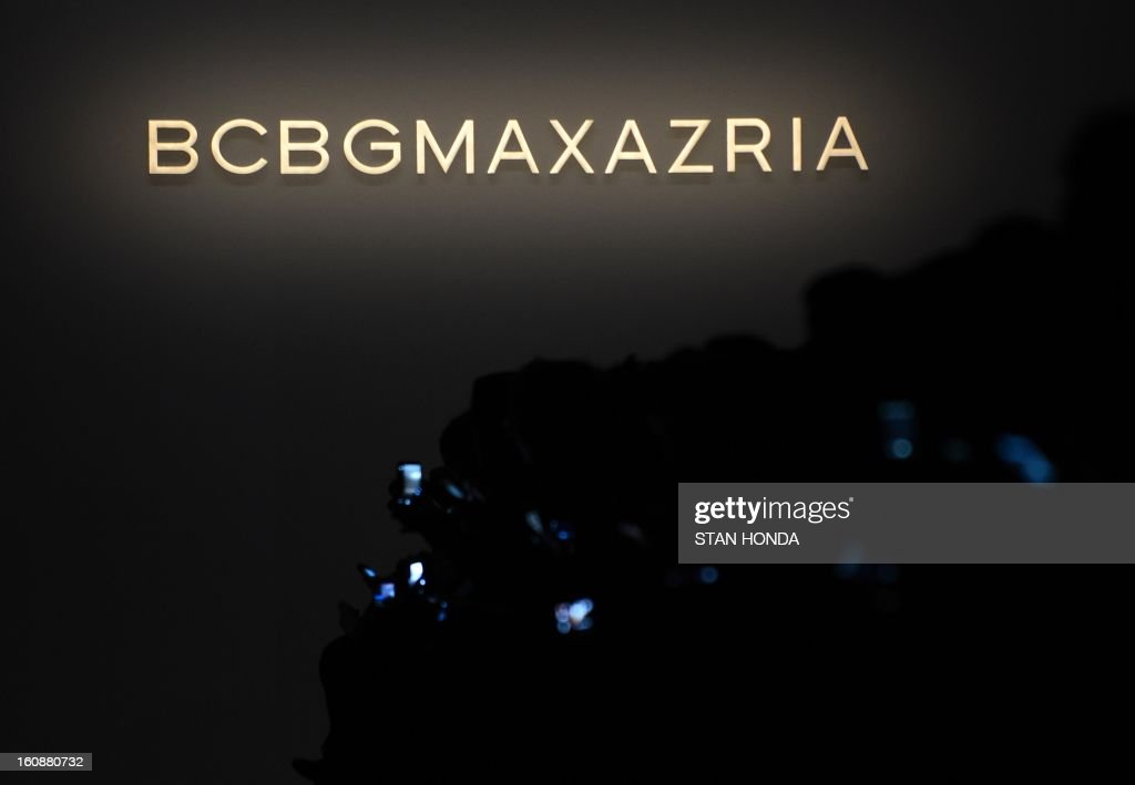 Smartphone screens glow at the BCBGMaxAzria show during the Mercedes-Benz Fashion Week Fall 2013 collections on February 7, 2013 in New York. Fashion Week injected a bit of color and glamour into wintry Manhattan on Thursday, with the first of 300 autumn-winter collections for men and women unveiled on the runways. AFP PHOTO/Stan HONDA