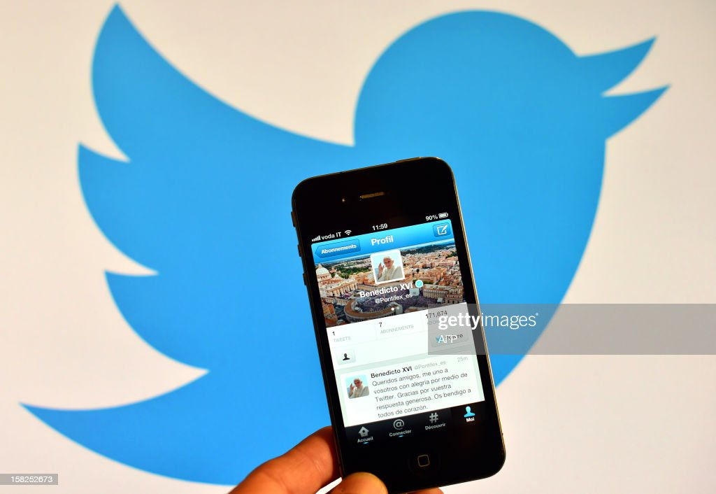A smartphone showing the first twitter message of Pope Benedict XVI in Spanish is held in front of a computer showing the logo of Twitter on December 12, 2012 in Rome. Pope Benedict XVI sent his first Twitter message from a digital tablet on Wednesday during his weekly general audience using the handle @pontifex, blessing his hundreds of thousands of new Internet followers.