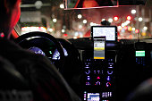 A smartphone showing the Kakao Taxi app developed by Daum Kako Corp sits mounted on the dashboard of a taxi in Seoul South Korea on Friday July 17...