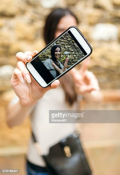 Smartphone with photo of smiling woman taking a selfie