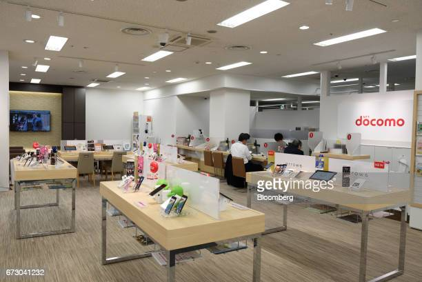 Smartphones and tablet devices sit on display inside an NTT Docomo Inc store in Tokyo Japan on Monday April 24 2017 NTT Docomo one of the world's...