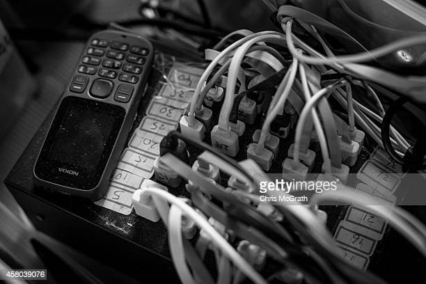 Smartphones are seen at a charging station setup by prodemocracy activists on the street outside the Hong Kong Government Complex on October 29 2014...
