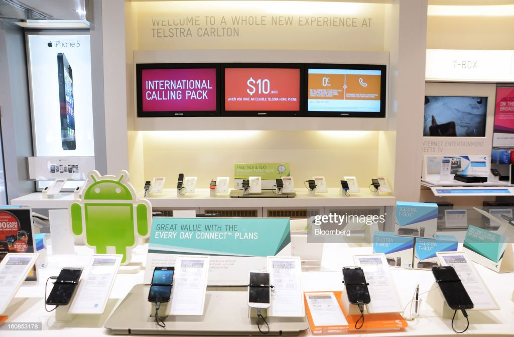 Smartphones sit on display at a Telstra retail outlet in Melbourne, Australia, on Thursday, Feb. 7, 2013. Telstra Corp., Australia's largest phone company, posted first-half profit that matched analyst estimates as it added 607,000 new mobile customers. Photographer: Carla Gottgens/Bloomberg via Getty Images