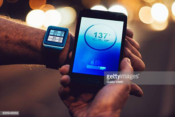 Smartwatch and smartphone showing data.