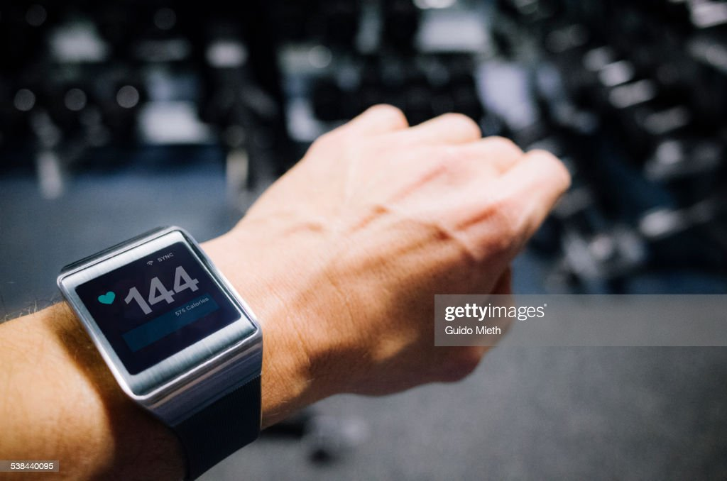 Smartwatch showing pulse. : Stock Photo