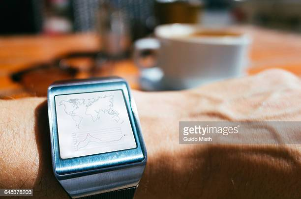 Smartwatch showing trading data.