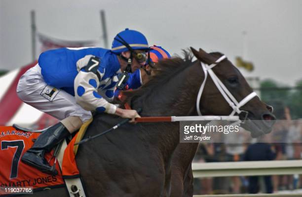 Smarty Jones with Jockey Stewart Elliot takes the lead in the final turn at the Preakness Stakes Pimlico Race Course Baltimore MD May 15 2004 Smarty...