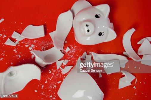 A smashed empty piggy bank