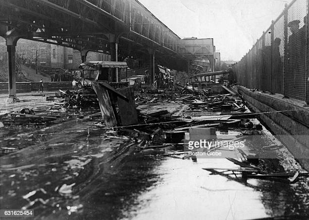 Smashed vehicles and debris sit in a puddle of molasses on Commercial Street on Jan 16 the day after a giant tank in the North End collapsed sending...