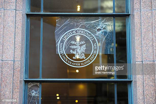 A smashed window is pictured at the Lindt Cafe at Martin Place on June 3 2015 in Sydney Australia Sydney's Lindt Cafe had its windows broken by...