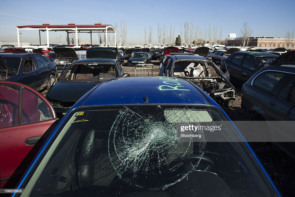 A smashed windscreen is seen on a scrapped vehicle in the yard of the Desguaces La Torre scrapyard in Madrid, Spain, on Thursday, Dec. 13, 2012. Spain has completed the debt sales it planned for this year and started raising funds for 2013, buying time for Prime Minister Mariano Rajoy as he decides whether to seek a European bailout. Photographer: Angel Navarrete/Bloomberg via Getty Images