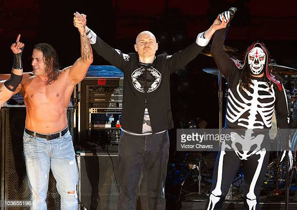 Smashing Pumpkins lead singer Billy Corgan and a group of Mexican wrestlers perform perform during the 2010 MTV World Stages concert at the Auditorio...