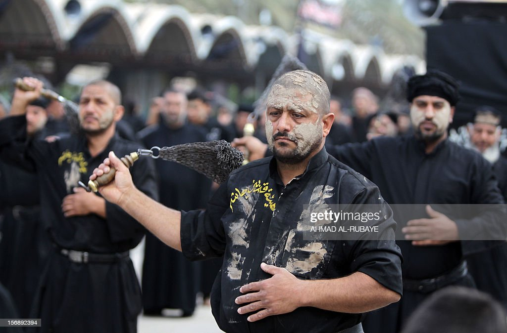 Smeared with mud, Shiite Muslim pilgrims beat themselves with metal chains as they take part in a parade in preparation for the peak of the Ashura ceremony, near the shrine of Imam Hussein in Karbala, some 80 kilometers (50 miles) southwest of Baghdad, on November 24, 2012. Hundreds of thousands of pilgrims have been gathering in the holy city throughout the week with Ashura rituals peaking on November 25, marking the death of Imam Hussein, the grandson of the Prophet Mohammad, in the seventh century.