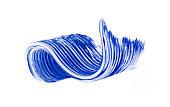 Smears of blue mascara isolated on white