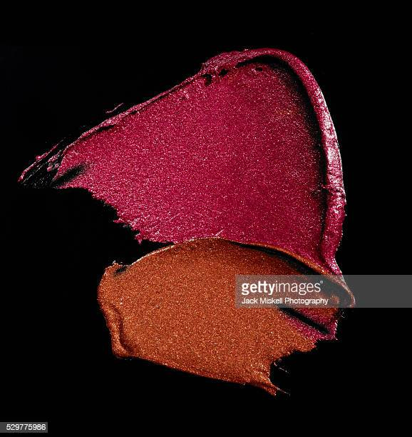 Smears of shimmering lipstick