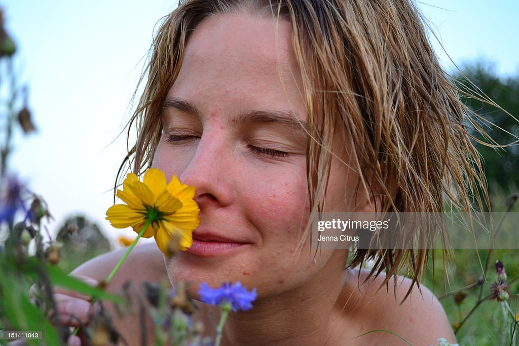Smelling flowers : Stock Photo