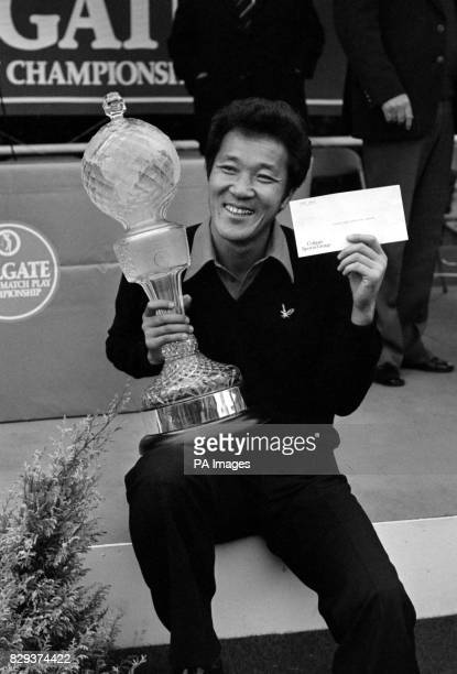A smile as Isao Aoki of Japan holds the trophy and 30000 prize cheque after winning the Colgate World Matchplay Championship at Wentworth Golf Club...